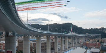 epa08582282 The 'Tricolour Arrows' (Frecce Tricolori), aerobatic demonstration team of the Italian Air Force, during the inauguration ceremony of the Genoa's new viaduct, two years after its predecessor, the Morandi bridge, collapsed in a disaster that claimed 43 lives, in Genoa, northern Italy, 03 August 2020. The new structure has been named Genoa San Giorgio Bridge.  EPA-EFE/LUCA ZENNARO