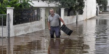 epa08680394 A man walks in a flooded street caused by the Mediterranean hurricane (Medicane) Ianos, in Orea Eleni Natural Thermal Spring, Corinth, Peloponnese, Greece, 19 September 2020. Since Ianos made landfall overnight on 17 September morning, the Fire Brigade has received a total of 2,450 throughout Greece for help and pumping out of flood water. Most calls for help came from the southern Ionian Islands, western Greece (which, along with sections of NW Peloponnese, were under a state of emergency), Central Greece and Thessaly. Several operations are still active, while the total calls include 619 completed rescues. A farmer who went missing in Karditsa, was found dead.  EPA-EFE/VASSILIS PSOMAS