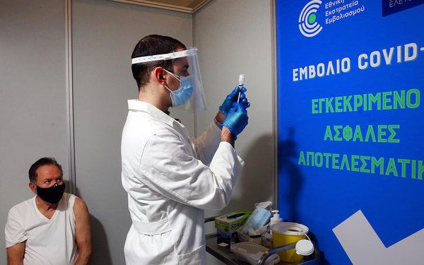 epa09014065 A manwaits to receive a shot of the first dose of the Moderna vaccine against the coronavirus disease (COVID-19), in a new vaccination center in Athens, Greece, 15 February 2021.  EPA-EFE/ORESTIS PANAGIOTOU
