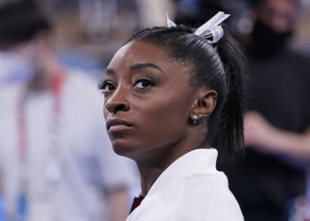 Simone Biles, of the United States, waits for her turn to perform during the artistic gymnastics women's final at the 2020 Summer Olympics, Tuesday, July 27, 2021, in Tokyo. (AP Photo/Gregory Bull)
